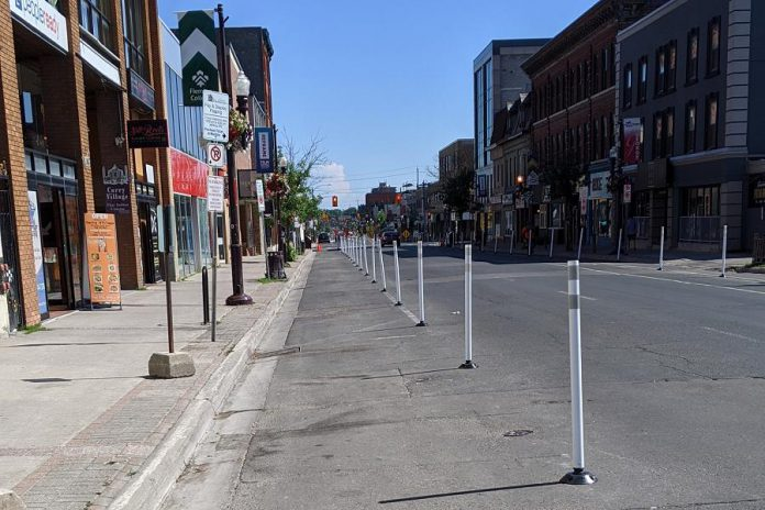 Sections of George and Water streets are restricted to vehicular traffic to create extra space for pedestrians on the roadway as restaurant patios and pop-up commercial space make use of the sidewalks. (Photo: Bruce Head / kawarthaNOW.com)
