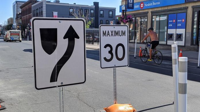 The cycling lanes on George Street and Water Street are unaffected by the changes. Road signage for reduced lanes, speed limits, and one-way streets is already in place. (Photo: Bruce Head / kawarthaNOW.com)