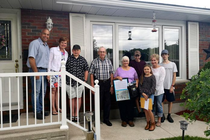 One of Peterborough's two Grandparents of the Year, Darlene Buchanan of Havelock (fifth from right), with her nominator  Ali Buchanan (third from right). Other members of the Buchanan family pictured from left to right: Steve, Marilyn, Bradley, Wayne, Cameron, Tammy, and Devin. Gordon Rosborough of Selwyn Township (not pictured) was also named Grandparent of the Year. (Photo courtesy of Community Care Peterborough)