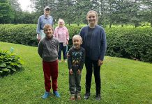One of Peterborough's two Grandparents of the Year, Gordon Rosborough of Selwyn Township (pictured rear left with his wife Doris) and his nominator Natalie Grace Garbutt (front right) with siblings Issac and Ethan. Darlene Buchanan of Havelock (not pictured) was also named Grandparent of the Year. (Photo courtesy of Community Care Peterborough)