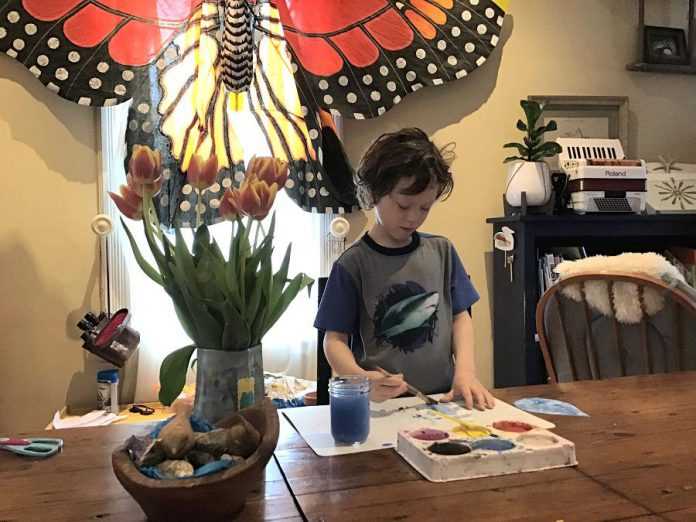 Rio Holland paints his love of water with a Love Drop activity, just one of the many activities available for children through GreenUP's Wonders of Water Water Wednesday online content. (Photo courtesy of GreenUP)