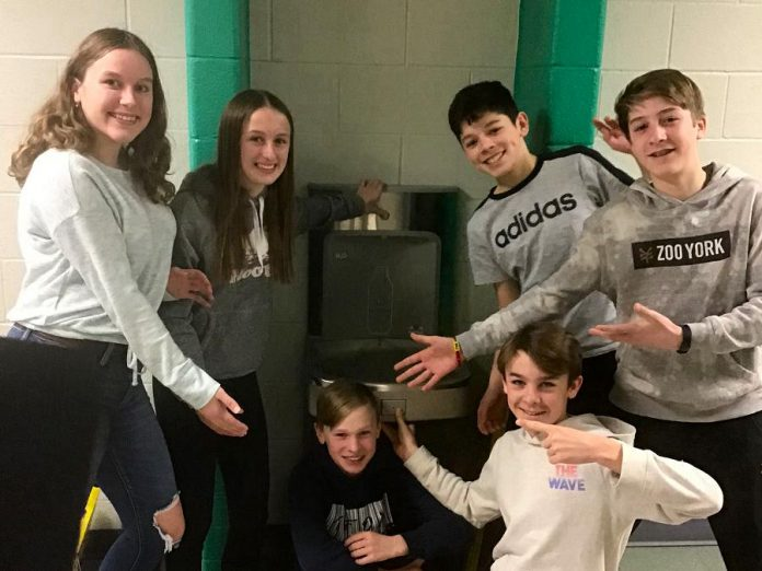 """Before schools were closed due to the COVID-19 pandemic, Grade 8 students at Monsignor O'Donaghue Catholic Elementary School showed off a newly installed water bottle refill station at the school, part of a student-led project called """"CAPS off Water"""", an acronym representing the conservation, awareness, protection, and stewardship of water. GreenUP has awarded the students its School Engagement Award for their work on the project. Pictured from left to right: Shannon Elliott, Molly Sharman, Jacob Colocci, John Velasquez, Cooper Cook, and Noah Bowler. (Photo: GreenUP)"""