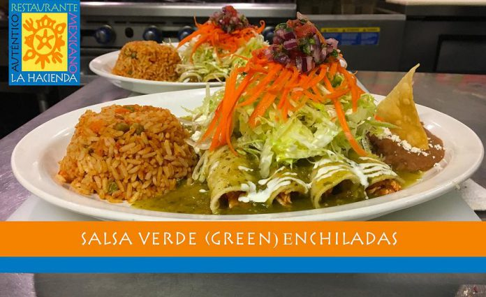 La Hacienda's enchiladas are lightly seasoned corn tortillas wrapped around chicken tinga or homemade refried beans, with salsa verde and garnished with shredded iceberg lettuce, crumbled cheese, and drizzled with sour cream. Mexican rice and homemade refried beans are served on the side. (Photo courtesy of La Hacienda)