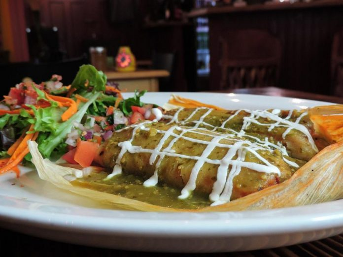"La Hacienda's traditional ""tamal"" features corn dough filled with pork loin in adobo sauce or vegetables, wrapped in a corn husk and steam-cooked to perfection. (Photo courtesy of La Hacienda)"