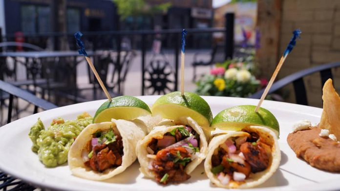 La Hacienda's tacos feature soft gluten-free corn tortillas filled with tender marinated pork loin and pineapple or mushrooms, served with the famous La Hacienda guacamole and refried beans. (Photo courtesy of La Hacienda)