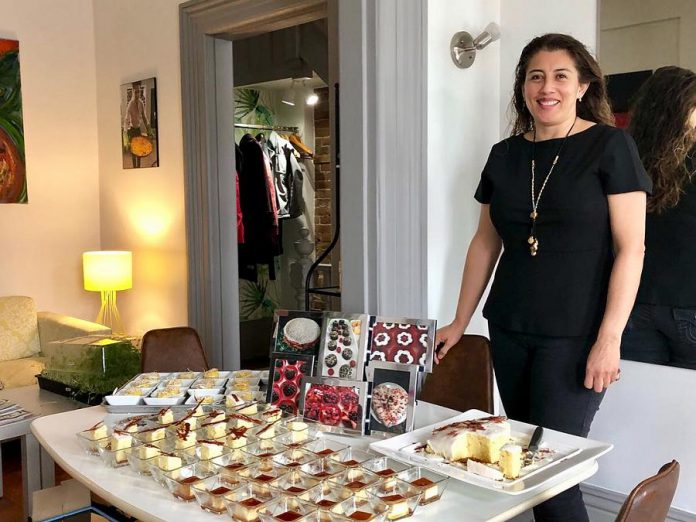 Leticia Cordova, owner of home-based business Maison du Chocolat Gourmet Bakery, with some of her desserts at a tasting at Fresh Dreams in downtown Peterborough in 2018. The Mexican native, who came to Peterborough in 2015 with her family, was a caterer in Mexico City and studied the culinary arts in France. She supplies desserts to Fresh Dreams and La Hacienda Mexican Restaurant as well as to customers across the Peterborough region. Here she displays her caramel flan, corn cake, and lime pound cake with lime icing. (Photo courtesy of Leticia Cordova)