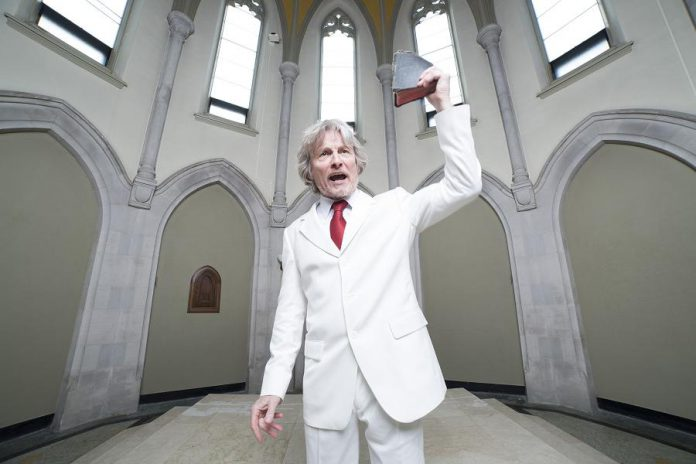 """Our writer Sam Tweedle received a call from Reverend Bobby Angel, a character created by and originally performed by Robert Winslow in """"Gimme That Prime Time Religion"""", a satire of the hypocrisy of televangelism. You can hear three monologues from that play performed by a 4th Line Theatre actor over the phone. (Photo: Wayne Eardley / Brookside Studio)"""