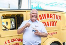 Premier Doug Ford enjoys a taste of Kawartha Dairy's famous ice cream during a visit to the family-owned dairy in Bobcaygeon on July 30, 2020. Early on during the pandemic, the Bobcaygeon community was devastated after 28 residents of Pinecrest Nursing Home passed away from COVID-19. (Photo: Samantha Moss / kawarthaNOW.com)