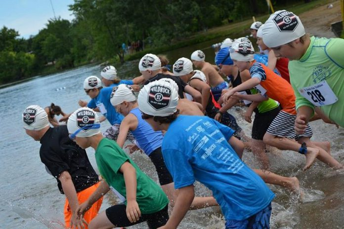 Children enter this water from the beach at Beavermead Park in Peterborough during a past Dr. Shufelt's Kids Triathlon. Organizers have cancelled the popular fundraising event in 2020 due to the COVID-19 pandemic. (Photo: Dr. Shufelt's Kids Triathlon / Facebook)