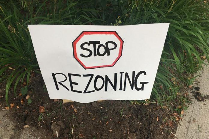 One of the many placards seen at the July 16, 2020 rally against a proposed high-density residential development on Armour Road in Peterborough.  (Photo: Paul Rellinger / kawarthaNOW.com)