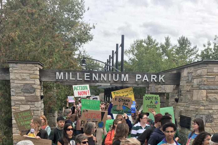 Following the Global Climate Action Day in Peterborough on September 27, 2019, a group of young people leave Millennium Park en route to the campaign offices of local candidates in the 2019 federal election. As the climate crisis continues, strategic stimulus spending plans have the potential to help business communities recover from the pandemic while also building a more resilient and sustainable economy to fight climate change. (Photo: Leif Einarson)