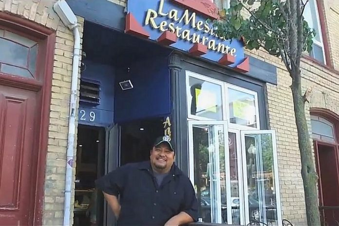 Martin Carbajal pictured in a video in front of his restaurant at 229 Hunter Street West in downtown Peterborough in 2018, when he was nominated for the Immigrant Entrepreneur of the Year Award at the Peterborough Chamber of Commerce's Business Excellence Awards. He went on to win the award. (Screenshot: Peterborough Chamber of Commerce)