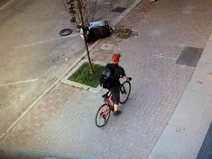 This man is wanted in connection with a purse-snatching incident in Lindsay on July 26, 2020. (Police-supplied photo)