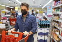 A middle-aged man wearing a face mask in a store. (Stock photo)