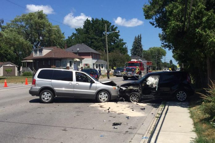 The scene of a head-on collision on Ontario Street in Port Hope on July 17, 2020. The driver of the silver Pontiac van has been charged with operation of a motor vehicle while prohibited and careless driving. (Photo: Port Hope Police Service)