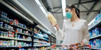 A woman wearing a face mask in a grocery store. (Stock photo)
