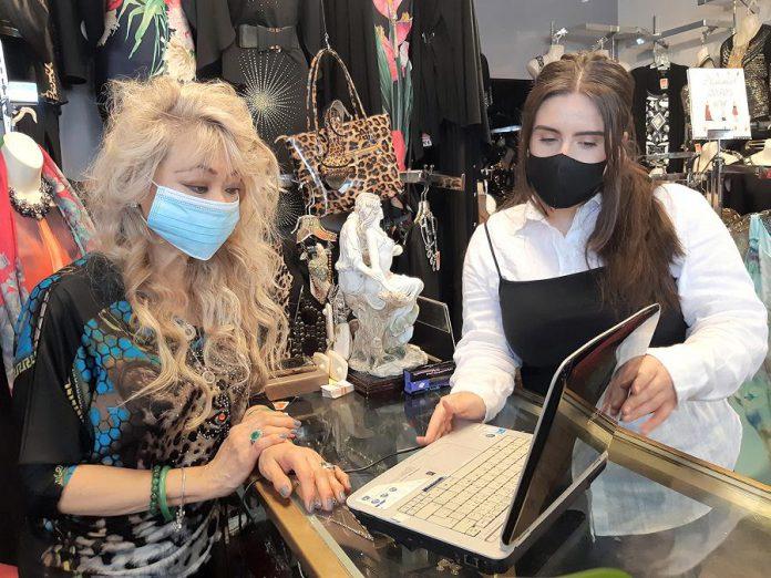 Lien Vu, owner of T-Elle Boutique on Charlotte Street, works with Digital Service Squad member Yllka Bojku on her digital transformation plan. (Photo courtesy of Peterborough DBIA)