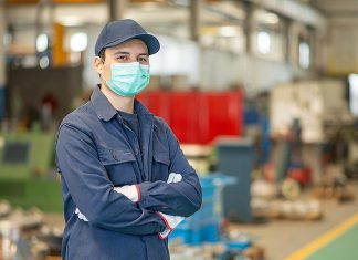 A factory worker wearing a mask. (Stock photo)