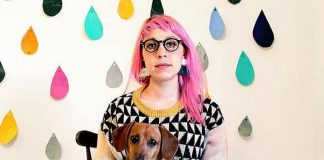 """Peterborough artist Kathryn Durst (pictured with her dog Chili) has been selected to create a public art mural in downtown Peterborough commissioned by the First Friday Ptbo Art Crawl. Trained in animation, Durst is now an illustrator of children's books, including Sir Paul McCartney's best-selling children's book """"Hey Grandude!"""", which was published in 2019. (Photo via First Friday Ptbo / Facebook)"""