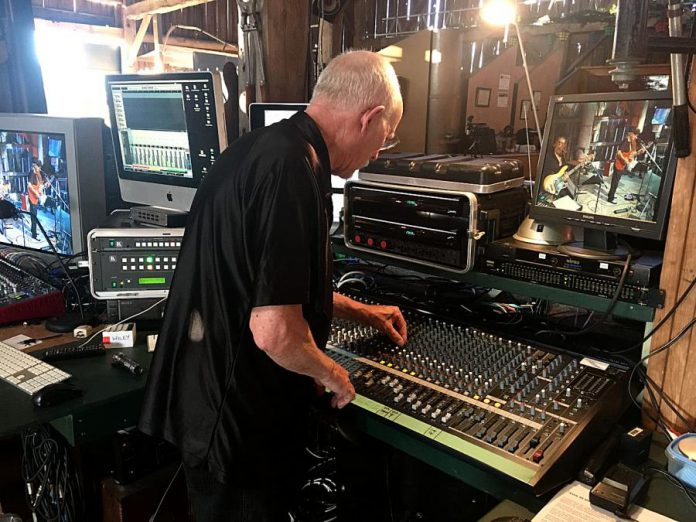 """Andy Tough of RMS Events works the sound board during the live-off-the-floor recording of Wylie Harold and Out On Bail on Thursday night (July 30) for the """"The Live! At The Barn"""" series. Andy is putting his audio and video recording skills to very good use during the pandemic, welcoming local music bands to his barn north of Norwood to record. The end result will be a series of shows posted to YouTube starting August 21, 2020. (Photo: Paul Rellinger / kawarthaNOW.com)"""