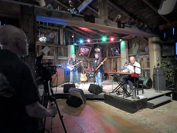 Andy Tough records a performance by local rock-blues-roots band The Fabulous Tonemasters for his new Live! At The Barn music performance video series. You can watch The Fabulous Tonemasters perform on Andy's YouTube channel beginning on August 28, 2020.  Viewers will have an opportunity to donate to the band. (Photo courtesy of Andy Tough)