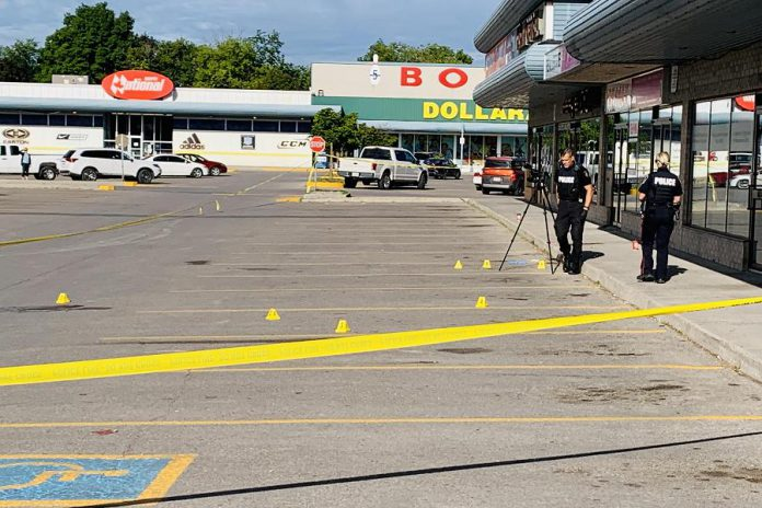Police cordoned off the parking lot at Market Plaza, located at the corner of George and Rink streets in Peterborough, as they documented the scene of a double stabbing the morning of August 18, 2020. Two Peterborough men have been arrested and charged following an investigation. (Photo courtesy of Brian Parypa)