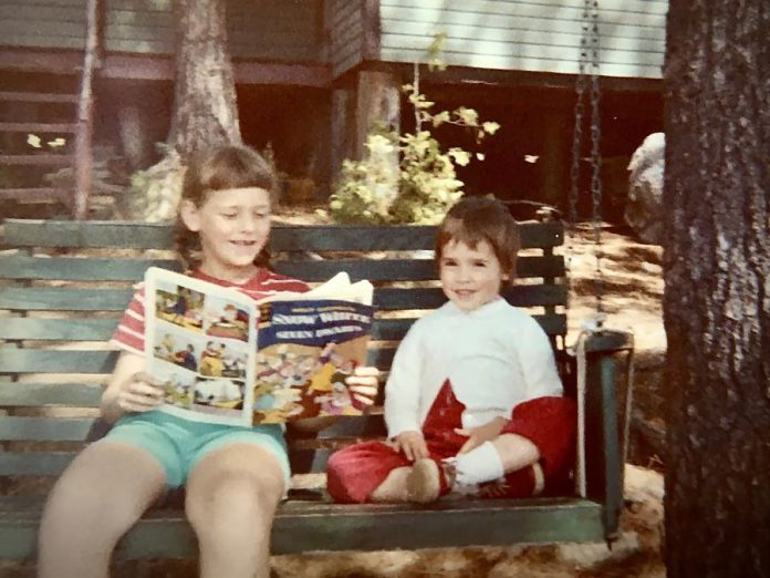 The author Suzanne McDonough (right) with her sister Cathy on their favourite swing in front of their family's Kawartha cottage in the 1960s. Because of the COVID-19 pandemic, the McDonough family has been unable to visit the beloved cotttage the family has owned since the 1930s. (Photo courtesy of Suzanne McDonough)
