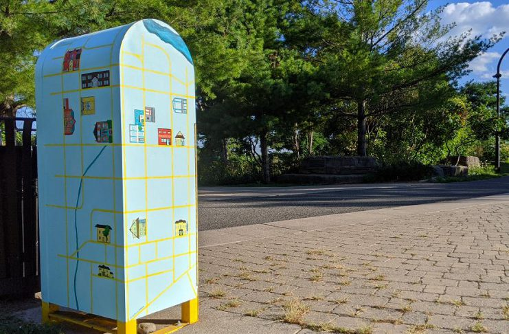 Local artist Bethany LeBlonc recently transformed this needle drop box in Peterborough's Millennium Park into a work of practical public art. Her colourful design also includes a map of social support resources available in downtown Peterborough for people who are disposing of used needles in the box. (Photo: Bruce Head / kawarthaNOW.com)