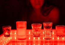 Alcoholic drinks being served in a strip club. (Stock photo)