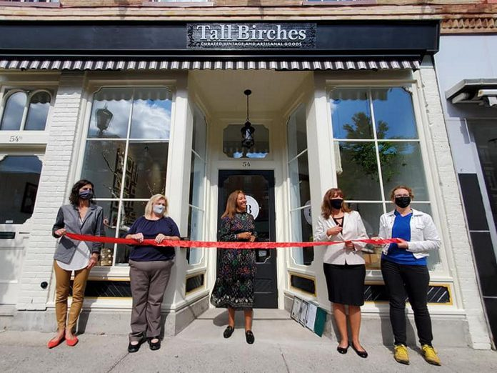 Tall Birches owner Autumn-Leeh Saunders (middle) at the official ribbon-cutting of her new Port Hope store. (Photo: Tall Birches / Facebook)