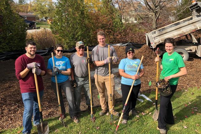 Unlike this 2019 planting of a 101-square-metre rain garden at the Warsaw municipal office on South Street, the September 25th planting will require participants to maintain two metres of physical distancing, sanitize tools, use a provided hand-washing station, and bring their own gardening gloves, tools, water, and food. (Photo: Jacob Rodenburg)