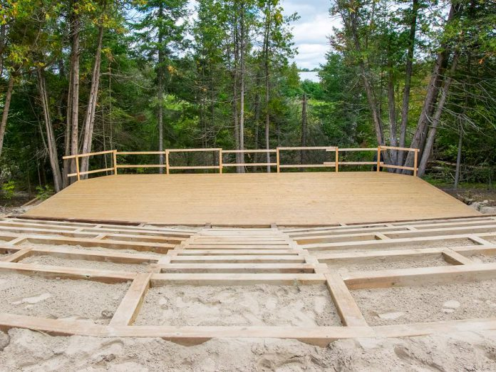 The 420-seat outdoor amphitheatre being constructed at Fenelon Falls fairgrounds will be home to The Grove Theatre, a newly launched professional theatre company that will produce a summer festival of live performance. The amphitheatre will also be used for concerts and other community events. (Photo courtesy of Kawartha Works Community Co-operative)