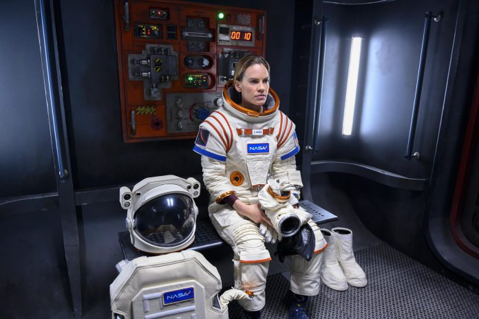 In the Netflix series 'Away', Commander Emma Green (Hilary Swank) leaves behind her husband and daughter to lead an international crew of astronauts on a perilous three-year mission to Mars. Inspired by Port Hope writer Chris Jones' 2014 Esquire article about American astronaut Scott Kelly's year in space, the series debuted on September 4, 2020. Jones also wrote one of the series' 10 episodes. (Photo: Netflix)
