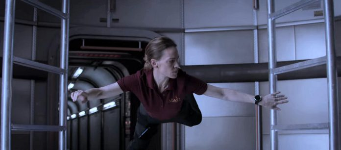 """Hilary Swank floating in zero gravity in a scene from 'Vital Signs', the eighth episode of """"Away"""" and one that was written by Port Hope's Chris Jones. (Screenshot)"""