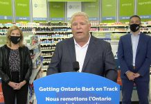 Ontario Premier Doug Ford, accompanied by health minister Christine Elliott and Shoppers Drug Mart president Jeff Leger, at a media conference on September 23, 2020 at Shoppers Drug Mart in Huntsville, where he announced COVID-19 tests for people without symptoms will be available at 60 pharmacies in Ontario. (CPAC screenshot)
