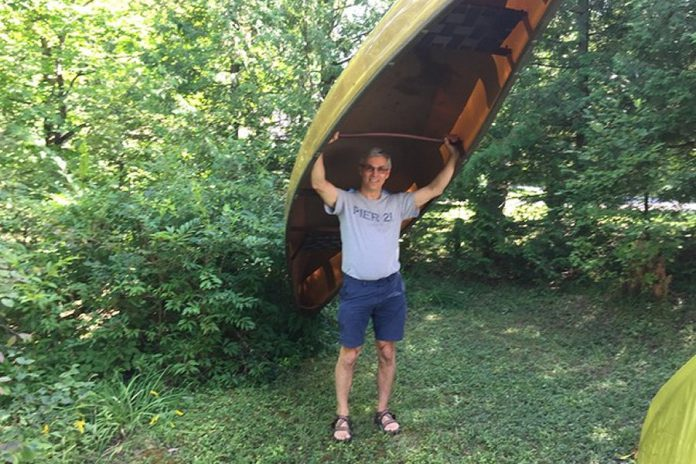 Paul Plant, who lost his wife Karen Hoffman to ovarian cancer last year, raised almost $4,000 for the 2019 Ovarian Cancer Canada Walk of Hope in Peterborough by committing to carry his canoe on his shoulders for five kilometres. For the 2020 virtual walk, Plant will be carrying his canoe from downtown Peterborough into East City and back while volunteers collect donations. (Photo courtesy of Paul Plant)