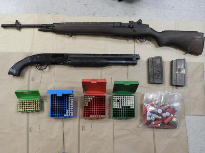 Police seized two weapons and 1,600 rounds of ammunition, along with a quantity of cocaine, from a Peterborough home on September 24, 2020. Two Peterborough residents face gun and drug charges. (Police-supplied photo)
