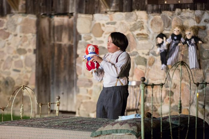 """Lev Khaimovich as Samuel Deyell in 4th Line Theatre's """"Bedtime Stories and Other Horrifying Tales"""". The outdoor production begins in the barnyard area of the Winslow Farm, where the audience is introduced to the Deyell family. The audience then follows the play's characters on an immersive promenade experience over around one kilometre of the property. (Photo: Wayne Eardley / Brookside Studio)"""