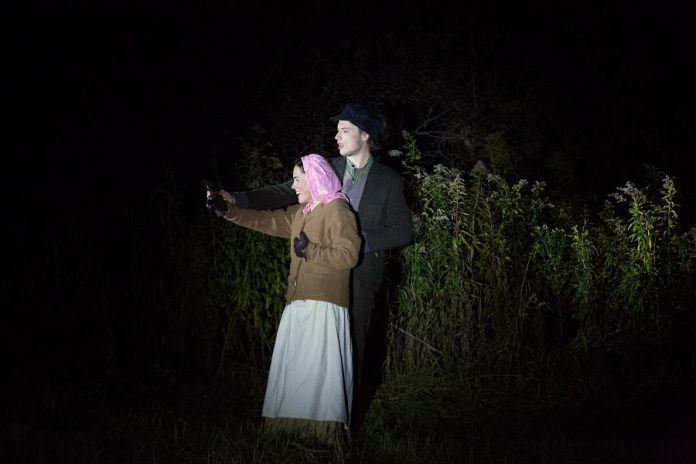 """Madison Sheward as Maggie Deyell and Tristan Peirce as Paddy Maguire  in 4th Line Theatre's """"Bedtime Stories and Other Horrifying Tales"""".  (Photo: Wayne Eardley / Brookside Studio)"""