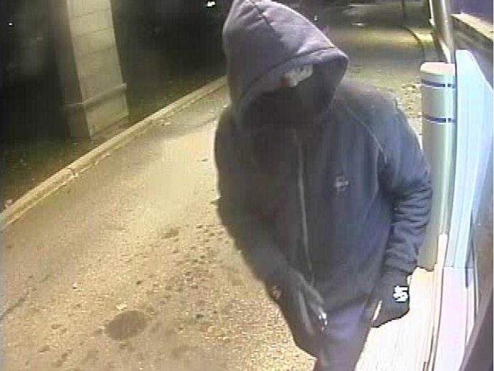 Security camera footage of a suspect in two robberies at ATMs in Coboconk and Orillia,  where he brandished a conducted energy weapon and demanded cash. The same man is believed to be responsible for two robbery attempts at convenience stores in Gravenhurst. (Police-supplied photo)