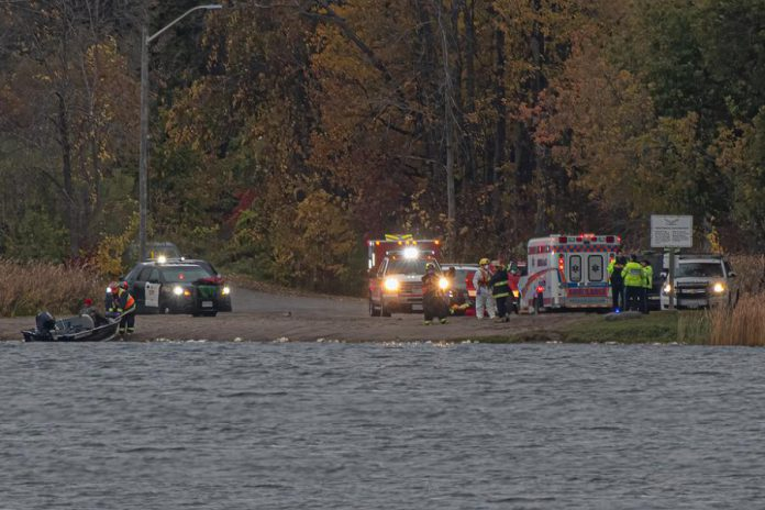 Police and emergency services respond to a boating accident on Chemong Lake off the shores of Curve Lake First Nation on October 18, 2020. Of the four people on a capsized fishing boat, one male is dead, another male is missing, one female has life-threatening injuries, and another female has minor injuries. (Photo courtesy of Maris Lubbock)