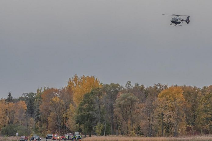 An OPP helicopter searching for a missing male after a boating accident on Chemong Lake off the shores of Curve Lake First Nation on October 18, 2020.  (Photo courtesy of Maris Lubbock)