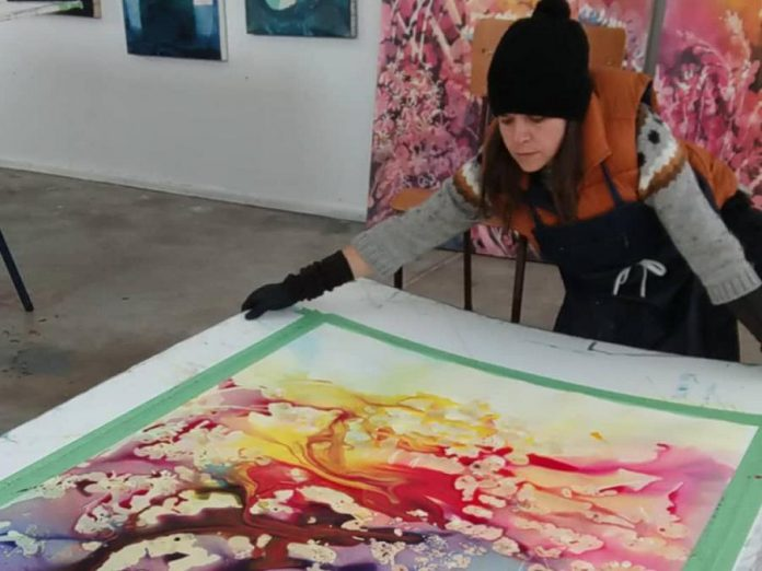 Artist Laura Madera at work. (Photo courtesy of the artist)