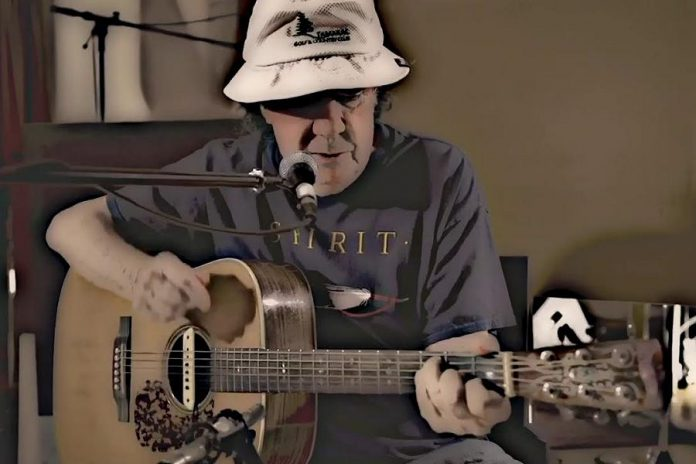 """Omemee's Bob Young was inspired to write """"Hey America"""" after watching Donald Trump on TV. His family and close friends encouraged the 78-year-old former golfer to record the song. The video was shot at Gores Landing Hall, south of Rice Lake. (Screenshot)"""