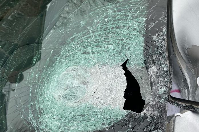 The windshield damage caused by the five-pin bowling ball. The complainant sustained minor injuries that did not require medical attention.  (Police-supplied photo)