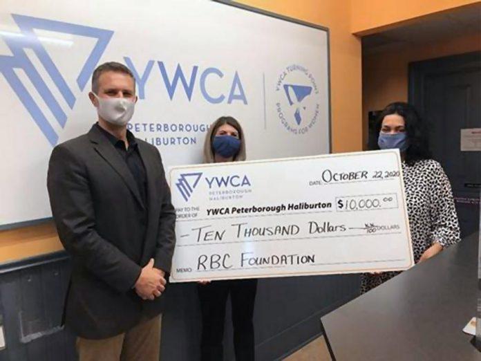 RBC's Scott Mancini and Karalee Murray present a $10,000 donation to Ria Nicholson of YWCA Peterborough Haliburton. (Supplied photo)
