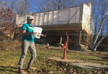 Deirdre McGahern, founder and president of Peterborough-based straw bale building company Straworks, outlines the unique features of the new health centre building quickly taking shape at Camp Kawartha on Clear Lake in Douro-Dummer. The 1,200-square-foot building is a shining example of next generation sustainable architecture, built exclusively with natural materials resulting in net-zero utility costs, zero toxins, zero fossil fuel use, and zero waste output for a zero-carbon footprint. (Photo: Paul Rellinger / kawarthaNOW.com)