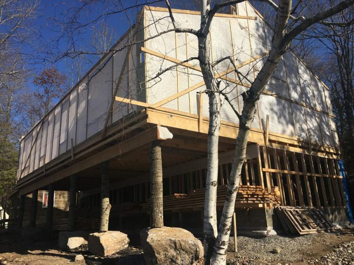 The new health centre at Camp Kawartha on Clear Lake in Douro-Dummer is expected to be completed and open by June 2021. It replaces the original health centre, a repurposed cabin built in the 1950s that had a sagging foundation, poor insulation, substandard facilities, and used a high amount of energy. (Photo: Paul Rellinger / kawarthaNOW.com)