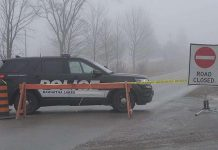A Kawartha Lakes police vehicle blocks access to Pigeon Lake Road east of Lindsay after a police shooting on November 26, 2020 that resulting in a 33-year-old suspect and an OPP officer being seriously injured. The suspect's one-year-old son was found fatally shot in the man's pickup truck. (Photo: CBC)