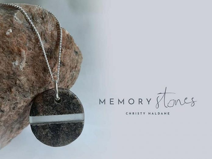 "Christy Haldane also creates custom ""Memory Stones"" that, like her vases and pendants, fuse glass with stone -- but you provide her with stones you have collected that have special meaning for you.  Memory Stones are available as pendants, lone sculptures, and memorial sculptures.  (Photo courtesy of Christy Haldane)"